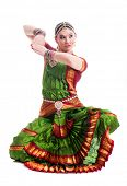 pic of bharatanatyam  - Bollywood dancer in green and orange folded dress posing as cobra - JPG