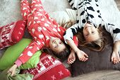 pic of pajamas  - Children in soft warm pajamas playing at home - JPG