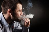 foto of marijuana cigarette  - guy in a business style with a cigar - JPG