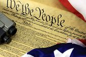 stock photo of guns  - US Constitution with Hand Gun  - JPG