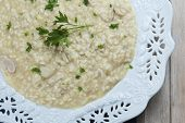 foto of porcini  - Porcini Mushroom risotto decorated with parsley and ready to be eaten - JPG