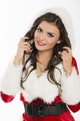 pic of flirtatious  - Portrait of gorgeous flirtatious sexy girl posing in Santa Claus outfit with hood over bright background - JPG