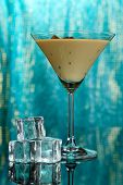 picture of bailey  - Baileys liqueur in glass on blue background - JPG