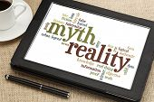 cloud of words or tags related to myth and reality on a  digital tablet