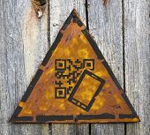 QR Code Icon on Weathered Warning Sign.
