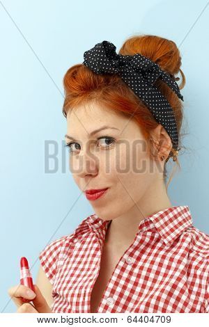 Pin-up Girl Holding Lipstick