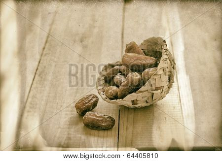 arabic dates in a traditional basket - grainy photograph effect