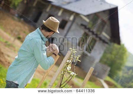 Young man working in the garden