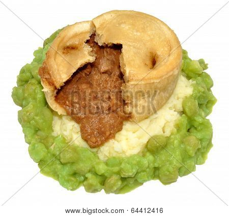 Steak And Kidney Pudding With Mashed Potato And Peas