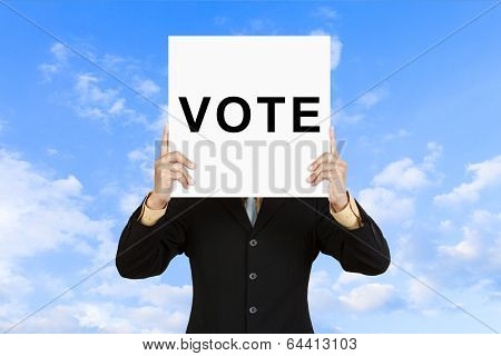 Businessman Show Wording Vote On Paper Board
