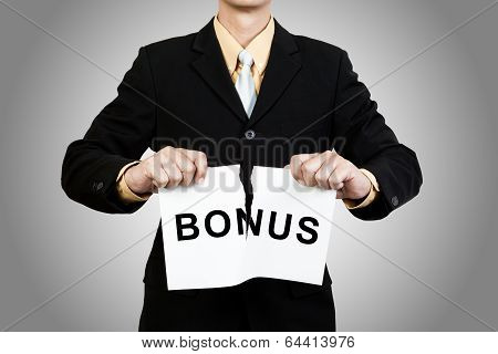Businessman Tear Paper With Word Bonus