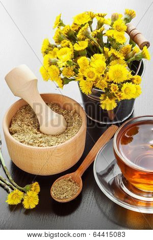 Healthy Tea, Bucket With Coltsfoot Flowers And Wooden Mortar On Table