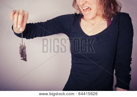 Disgusted Woman Holding Dead Mouse