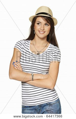 Smiling young woman in stripped tshirt and straw hat