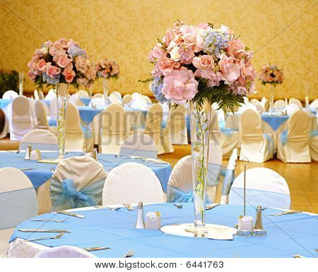 Wedding table setting with flowers in vases
