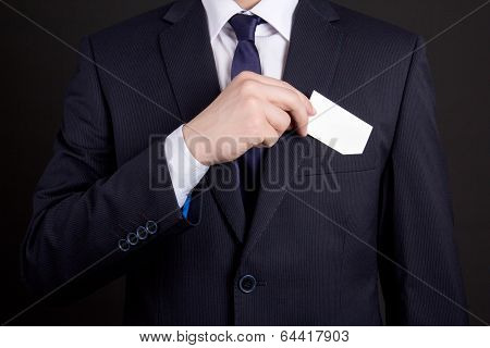 Businessman Holding Visiting Card Out Of His Suit Pocket