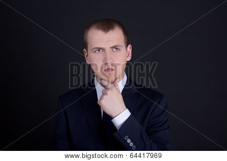 Business Man Thinking Or Dreaming Over Dark Background