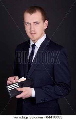 Business Man Holding Leather Purse With Euro Banknotes