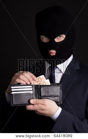 Man In Business Suit And Mask Holding Leather Purse With Euro Banknotes