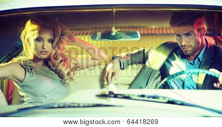 Sexy couple and old car