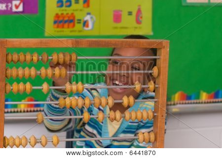 A Child With A Abacus