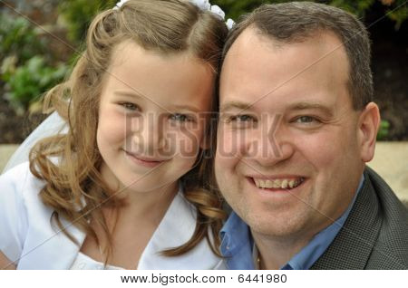 daddy and daughter on first communion day