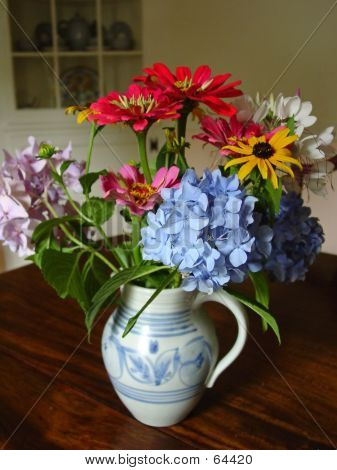 Bouquet In Antique Pitcher
