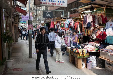 HONG KONG - NOVEMBER 14, 2012: Trading pedestrian Wing Kut Street (Sheung Wan) is a popular destination among tourists and locals. Here, small traders It is proposed various items for everyday life.
