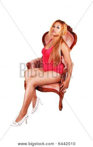 Red Haired Girl In Armchair.