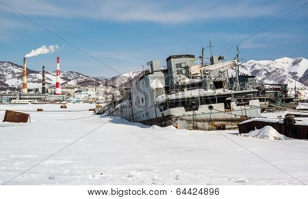 View Of Petropavlovsk-kamchatsky Deserted Vessels And Power Plant. Far East, Russia