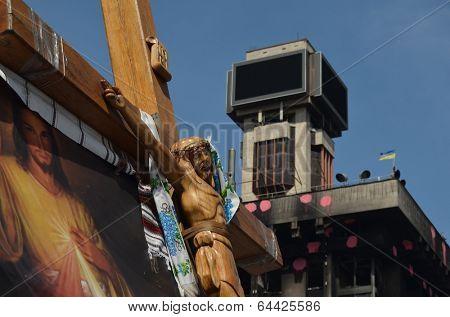 KIEV, UKRAINE - APR 28, 2014: Second crucifixion of Jesus.Burned downtown of Kiev.Rioters camp. Putsch of junta in Kiev and Western Ukraine.April 28, 2014 Kiev, Ukraine