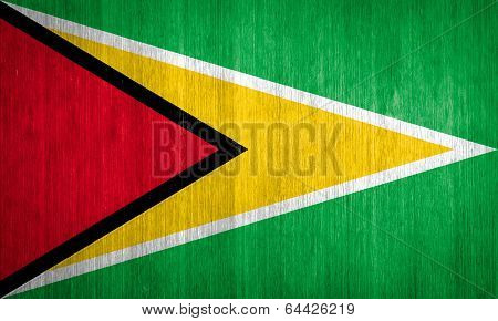 Guyana Flag On Wood Background