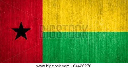Guinea-bissau Flag On Wood Background