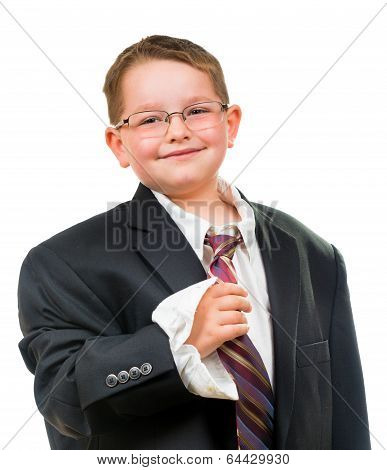 Happy child wearing suit that is too big for him