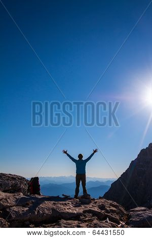 women silhouette on the top of mountain