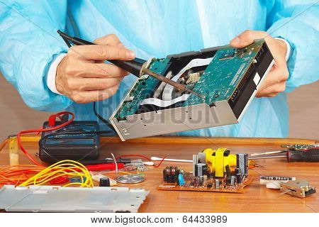Repair electronic board with a soldering iron in service workshop