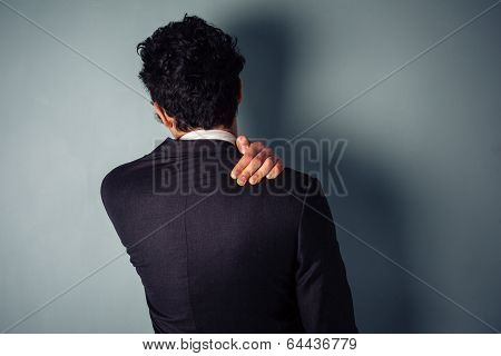 Businessman With A Sore Neck