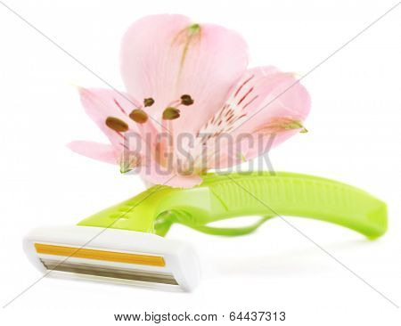 woman safety shaver and flower isolated on white