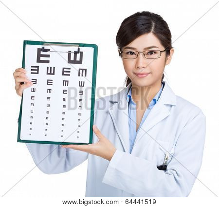Female doctor keeping optometry chart