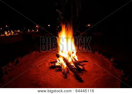Outdoor wood campfire burning brightly during the darkness of nighttime