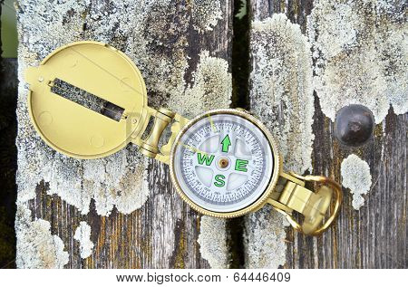Compass on the wooden background