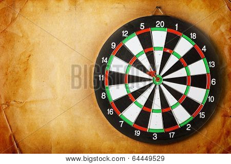 Vintage Dart Board On Dark Wall Grunge