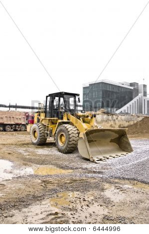 Yellow And Black Dusty Bulldozer Parked On The Construction Site