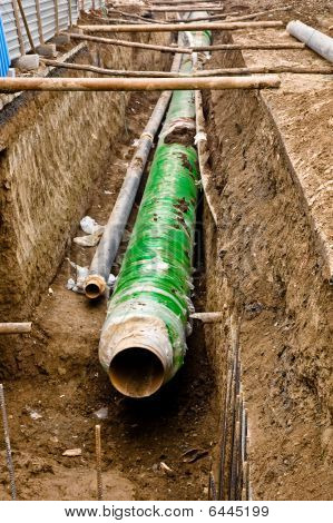 Metal Pipes With Thick Heat Isolation Lieing In The Trench.