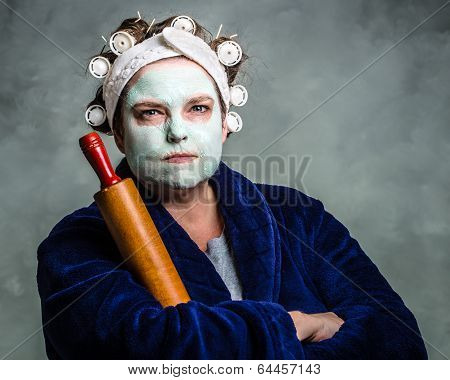 Mean And Ugly Housewife With Facial Mask, Hair Rollers And Rolling Pin