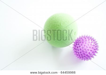 Purple and Green Stress Balls Isolated