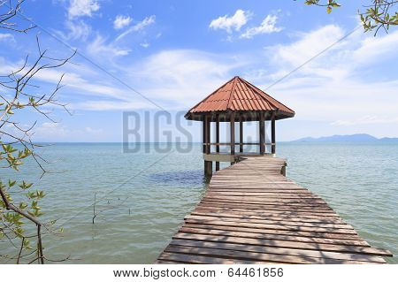 Wooden Pier With Pavilion In The Sea