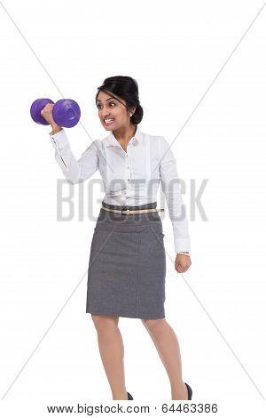 Businesswoman holding dumbbell