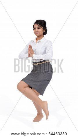 Businesswoman in yoga position