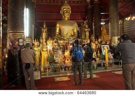 Luang Prabang - January 25 : Photographers Are Shooting Of Buddha Statues At Wat Mai In Luang Praban